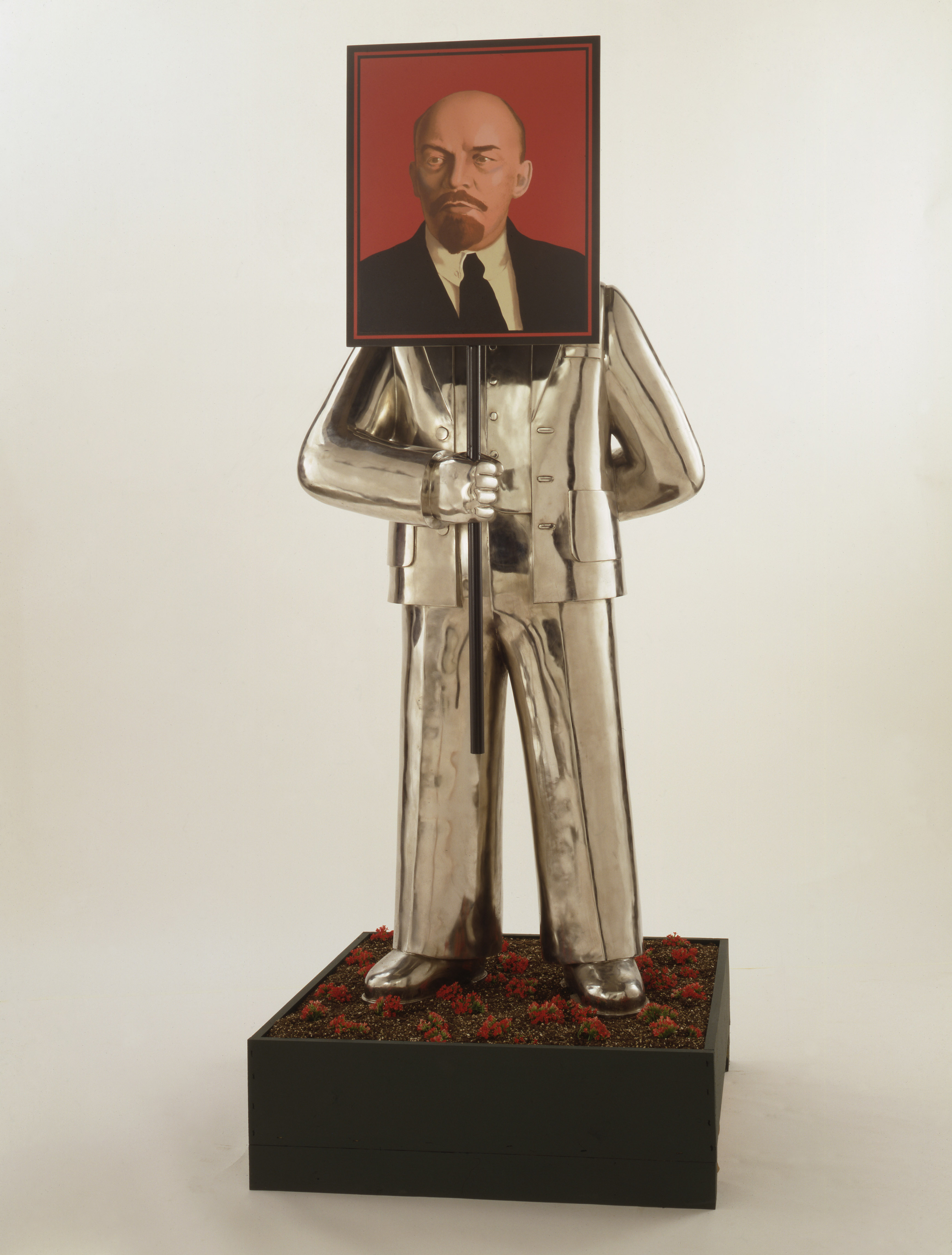 GRISHA BRUSKIN Man with Portrait of Lenin. (From the series Paradise Lost) 1990 Installation, stainless steel, aluminum, industrial enamel 200 x 86.4 x 68.5cm Image courtesy of the Sepherot Foundation, Liechtenstein